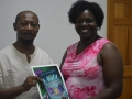 Alan Springer presents copies of his series eKidz to Librarian Sonja Smith
